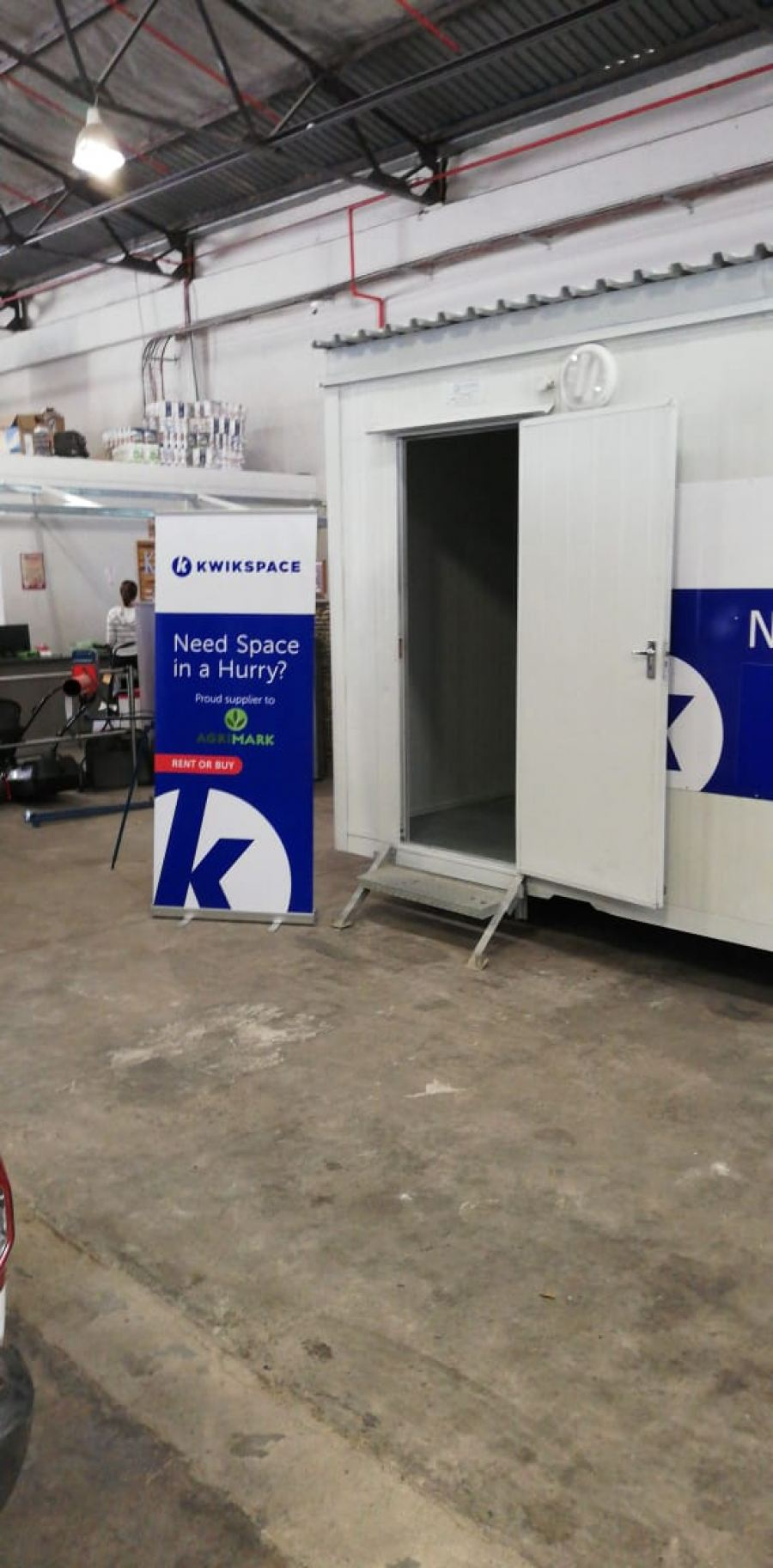 A portion of the Kwikspace relocatable unit at the Kaap Agri store in Paarl and one of the promotional banners. Sales personnel receive Kwikspace training and are perfectly positioned to answer any Kwikspace queries.