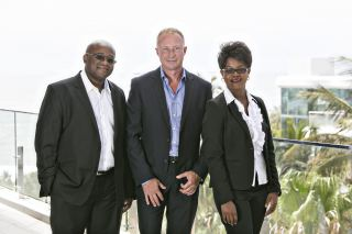 Regis Usaiwevhu (Tyson Properties Richards Bay), Chris Tyson (CEO) and Linah Marijeni (Tyson Properties Richards Bay).